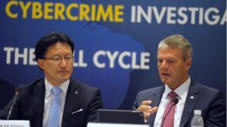 Troles Oerting and executive director of Interpol Noboru Nakatani