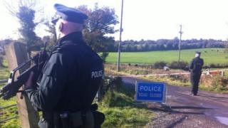 Police guard the outer cordon of the security operation