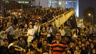 Pro-democracy protesters attend a rally in the occupied areas outside government headquarters in Hong Kong's Admiralty, 10 October 2014