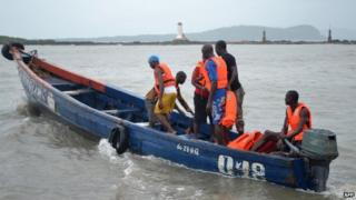 File photo: Rescue workers leave the coast to find the victims of a capsized boat in Conakry, 1 September 2012