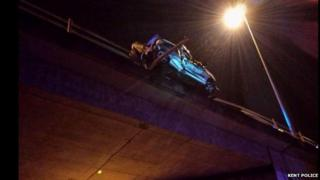 Car hanging over M26