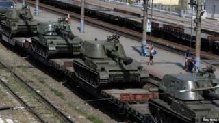 A freight car loaded with self-propelled howitzers is seen at a railway station in Kamensk-Shakhtinsky, Rostov region, near the border with Ukraine, 23 August 2014