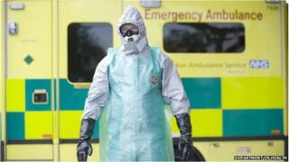 A paramedic in a protective suit