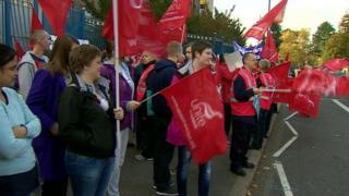 Health workers are striking in a dispute over pay