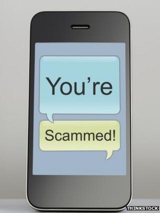 "phone with ""you're scammed"" message"