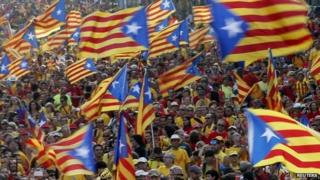 People hold Catalan separatist flags during a protest in central Barcelona - 11 September 2014