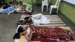People rest inside an evacuation centre in Managua after an earthquake shook Nicaragua on 13 October, 2014