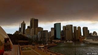 Smoke and ash from wildfires burning across the state of New South Wales blankets the Sydney city skyline. Photo: October 2013