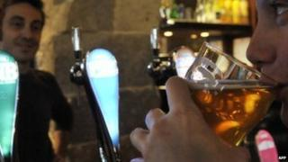 A French drinker enjoys a beer