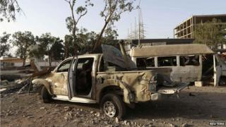 Destroyed vehicles in Benghazi, July 2014