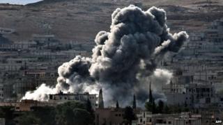 Smoke rises after an airstrike on Kobane