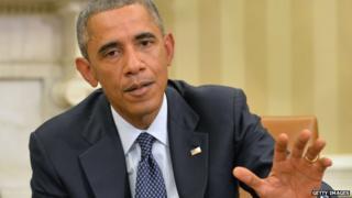 President Barack Obama talks with his Ebola Response Team on 16 October.