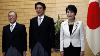 Japan's Prime Minister Shinzo Abe (C) poses for the media with new Economy, Trade and Industry Minister Yoichi Miyazawa (L) and new Justice Minister Yoko Kamikawa at Abe's official residence in Tokyo, Japan, 21 October 2014