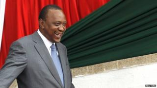 Kenya's President Uhuru Kenyatta leaves after attending the Mashujaa Day (Hero's Day) celebrations at the Nyayo National Stadium in Nairobi, on 20 October 2014.