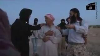 Screen grab of undated video purportedly showing an elderly Syrian man stoning his daughter to death