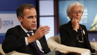 Bank of England's Mark Carney with Christine Lagarde at IMF-World Bank meetings in Washington. 12 October