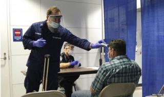 A passenger arriving from Sierra Leone is screened at O'Hare International Airport in Chicagoon 16 October 2014.