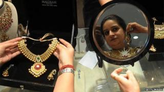 Indian woman trying on jewellery