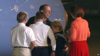 Jeffrey Fowle is greeted by family members upon his arrival at Wright-Patterson Air Force Base in Ohio on 22 October 2014