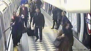 CCTV of woman whose scarf got trapped on 3 February 2014