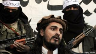 In this file photograph taken on November 26, 2008, shows Pakistani Taliban commander Hakimullah Mehsud speaking to a group of media representatives in the Mamouzai area of Orakzai Agency.