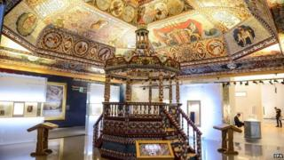 The reconstructed ceiling of the wooden synagogue from Gwozdziec village and Bimah, a platform in the synagogue, as part of the Jewish Town gallery