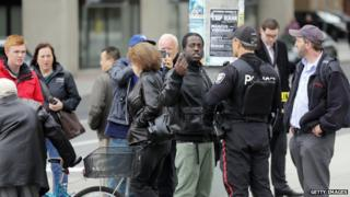 A police officer talks with a man near Parliament Hill in Ottawa on 22 October