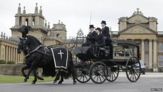 The duke's coffin being taken from Blenheim Palace in a horse-drawn carriage