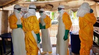 Health workers in Guinea, Sept 25