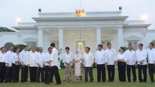 Indonesian President Joko Widodo shakes hands with his ministers