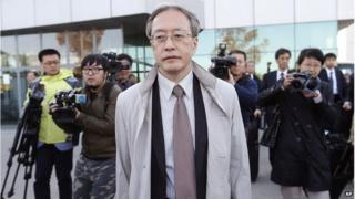 Junichi Ihara, centre, director general of the Asia and Oceania affairs bureau of Japanese Foreign Ministry, arrives at the Sunan International Airport, Monday, Oct. 27, 2014 in Pyongyang, North Korea