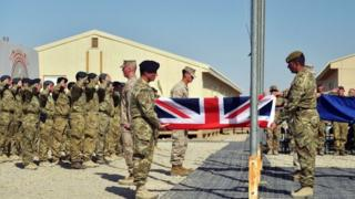 The British flag being lowered during a handover ceremony at Camp Bastion in Helmand province on October 26, 2014. British forces handed over control of their last base in Afghanistan to Afghan forces, ending combat operations in the country after 13 years.