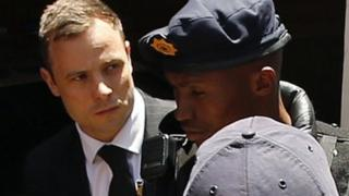 South African Olympic and Paralympic sprinter Oscar Pistorius being escorted to a police van after his sentencing at the North Gauteng High Court in Pretoria - 21 October 2014
