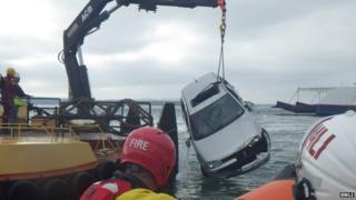 Car in the water at Sandbanks