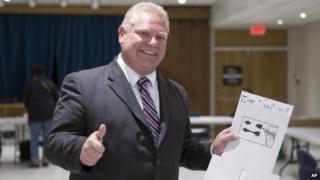 Toronto Mayoral Candidate Doug Ford gives a thumbs up to reporters after casting his ballot in advance voting for the Toronto Municipal Election at an Etobicoke polling station on 15 October 2014