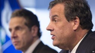 Governors Andrew Cuomo and Chris Christie announce their states's Ebola quarantine policies on 24 October.