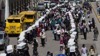 A procession of coffins with the exhumed bodies of 80 victims of Peru's internal conflict, October 27,2014