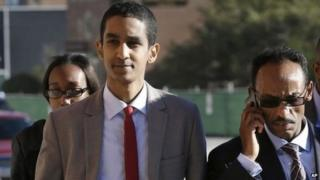 Robel Phillipos, front left, a college friend of Boston Marathon bombing suspect Dzhokhar Tsarnaev, arrives at federal court with defence attorney Derege Demissie, right, on a day of jury deliberations in his trial, Monday, Oct. 27, 2014, in Boston