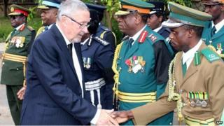 Zambia's Vice-President Guy Scott (L) greets defence and security chiefs shortly after taking over as acting president following Michael Sata's death on 29 October 2014