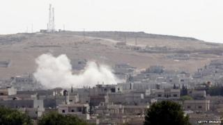 Smoke rises in Kobane, north Syria, after an air strike