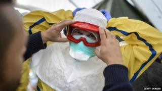 Health workers of the International Federation of Red Cross (IFRC) and medical charity Medecins Sans Frontieres (MSF) take part in a pre-deployment training for staff heading to Ebola areas 29 October 2014