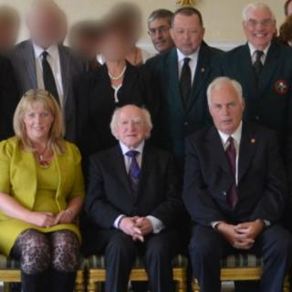 Elaine Hampton (L), Robert Graham, Stephen McAlister, Billy Allen and Gordon Knowles (R) pictured with Irish President Michael D Higgins