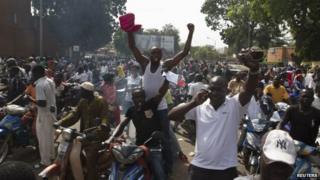 "People celebrate the departure of Burkina Faso""s President Blaise Compaore in Ouagadougou, capital of Burkina Faso"
