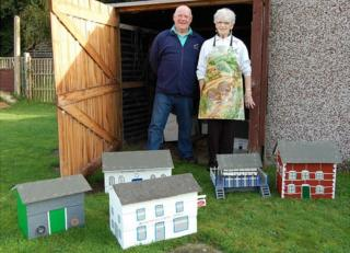 Beverley Lorking (left) and Pat Bullman in front of the restored model village buildings