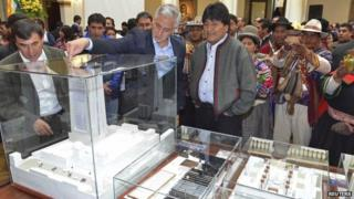 """President Evo Morales is shown the model for the """"Big House of the People"""" 31 Oct 2014"""
