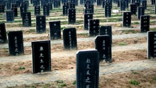 This picture taken on November 25, 2012 shows tombstones at a public cemetery that was built for the 'flatten graves to return farmland' campaign in suburb Zhoukou, central China's Henan province. Zhoukou has halted a campaign to clear graves for farmland after the demolition of more than two million tombs sparked outrage in a country where ancestors are traditionally held in deep respect.