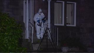 Forensic officer at the house