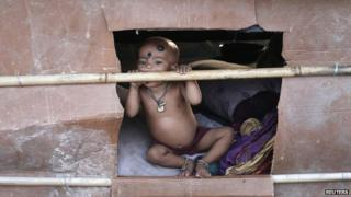 A child - whose parents say they belong to the Rohingya community from Burma - at a makeshift shelter in Delhi, India. Photo: September 2014