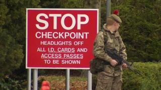 Soldier guarding checkpoint at Bassingbourn Barracks