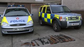 Police cars and rifles